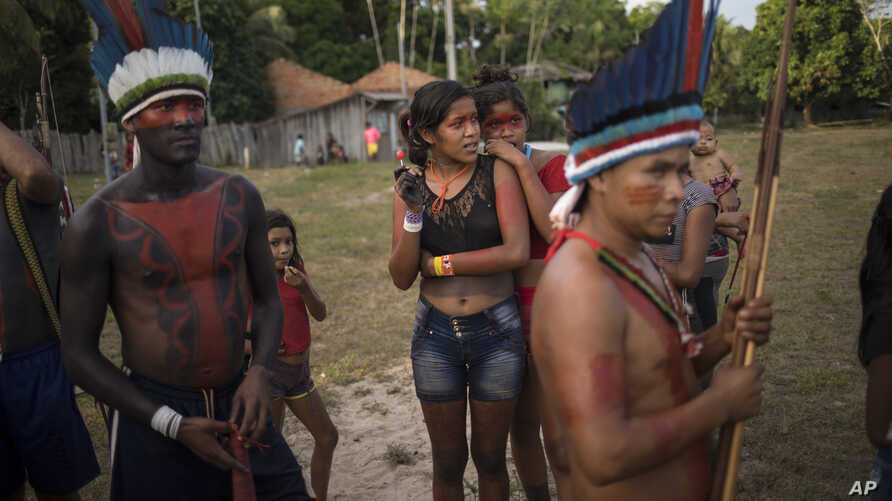 People gather for a meeting of the Tembe tribes in the Tekohaw village, in Para state, Brazil, Sept. 3, 2019.