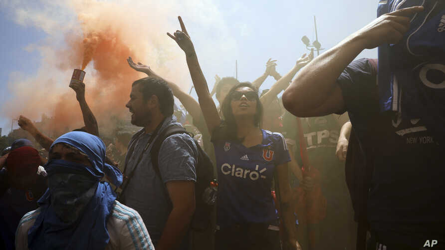 People protest during an anti-government demonstration in Santiago, Chile, Oct. 24, 2019.