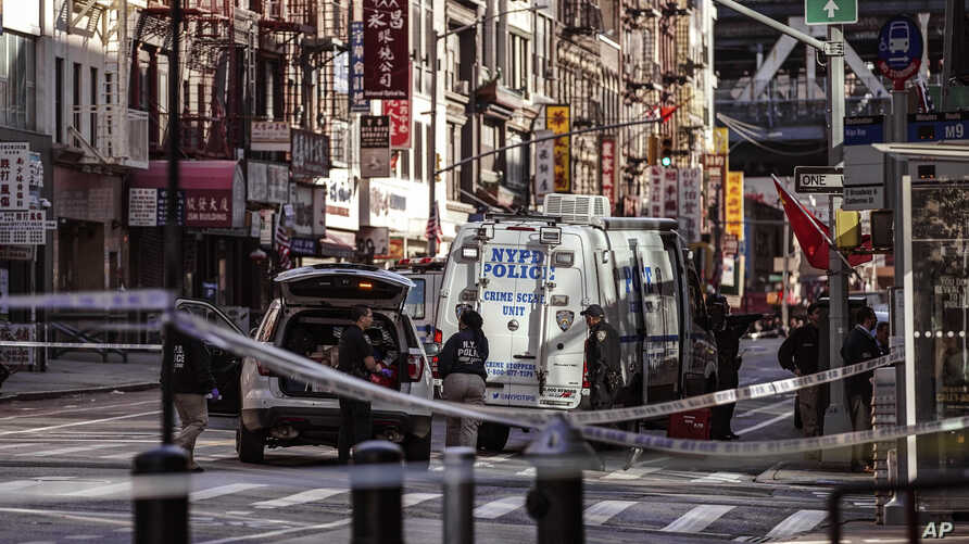 Police officers investigate the scene of an attack in New York's Chinatown neighborhood, Oct. 5, 2019.