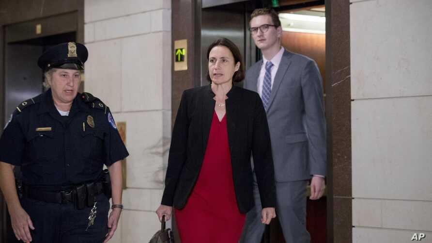 Former White House advisor on Russia, Fiona Hill, arrives on Capitol Hill in Washington, Oct. 14, 2019, as she is scheduled to testify before congressional lawmakers as part of the House impeachment inquiry into President Donald Trump.