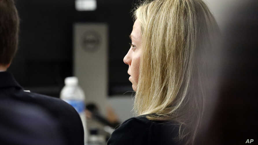 Fired Dallas police officer Amber Guyger listens as friends, family and coworkers speak in her defense during the sentencing phase of her murder trial, in Dallas, Texas, Oct. 2, 2019.