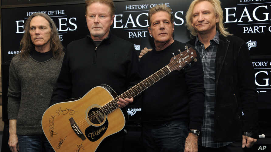 FILE - Members of the Eagles, from left, Timothy B. Schmit, Don Henley, Glenn Frey and Joe Walsh pose after a news conference at the 2013 Sundance Film Festival, in Park City, Utah, Jan. 19, 2013.
