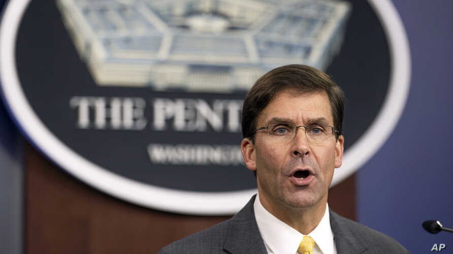 FILE - U.S. Secretary of Defense Mark Esper speaks to reporters during a briefing at the Pentagon, outside Washington, Aug. 28, 2019.