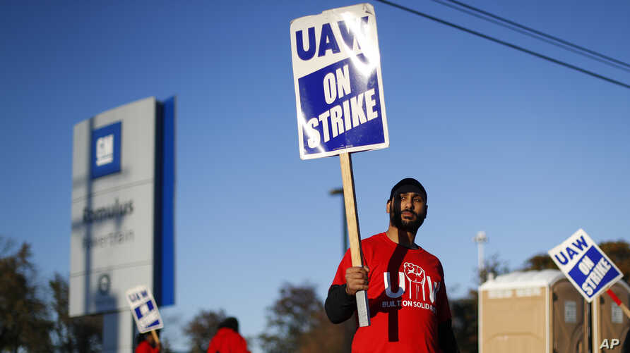 A member of the United Auto Workers walks the picket line at the General Motors Romulus Powertrain plant in Romulus, Michigan, Oct. 9, 2019.
