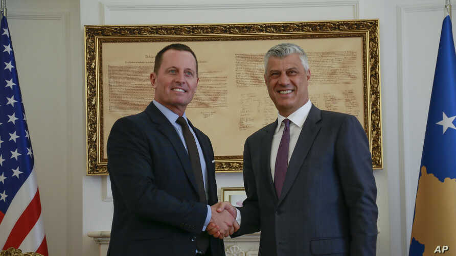 Kosovo President Hashim Thaci, right, shakes hands with President Donald Trump's envoy for the Kosovo-Serbia dialogue, Ambassador Richard Grenell, in Kosovo's capital of Pristina, Oct. 9, 2019.