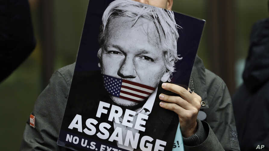 Supporters of Wikileaks founder Julian Assange demonstrate outside Westminster Magistrates' Court in in London where Assange is expected to appear to fight extradition to the United States, Oct. 21, 2019.