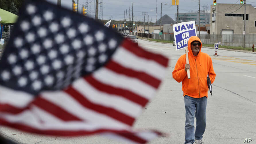 Rocky Perry, a 20-year General Motors employee, pickets outside the GM Fabrication Division, Oct. 16, 2019, in Parma, Ohio.