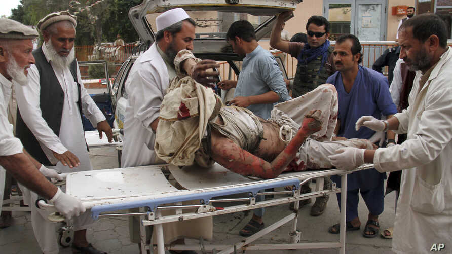A wounded man is brought by stretcher into a hospital after an explosion at a mosque in Haskamena district of Jalalabad, east of Kabul, Afghanistan, Oct. 18, 2019.