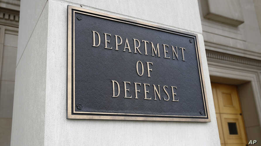 FILE - A photo shows a sign for the Department of Defense at the Pentagon building, in Arlington, Virginia, outside Washington, April 19, 2019.