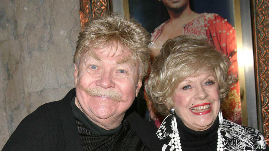 "FILE - Comedian Rip Taylor (L) and a guest at the opening of ""The King And I"" in Hollywood, California, April 5, 2005."