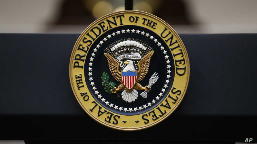 FILE - The Presidential Seal is seen on a lectern in the Roosevelt Room of the White House, in Washington, Sept. 4, 2019.