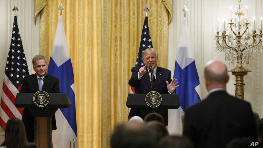 President Donald Trump, joined by Finnish President Sauli Niinisto, speaks during a news conference at the White House in Washington, Oct. 2, 2019.