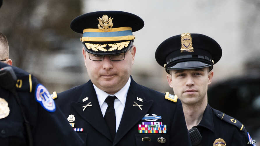 Army Lieutenant Colonel Alexander Vindman, a military officer at the National Security Council, center, arrives on Capitol Hill in Washington, to testify as part of the U.S. House of Representatives impeachment inquiry into President Donald Trump.