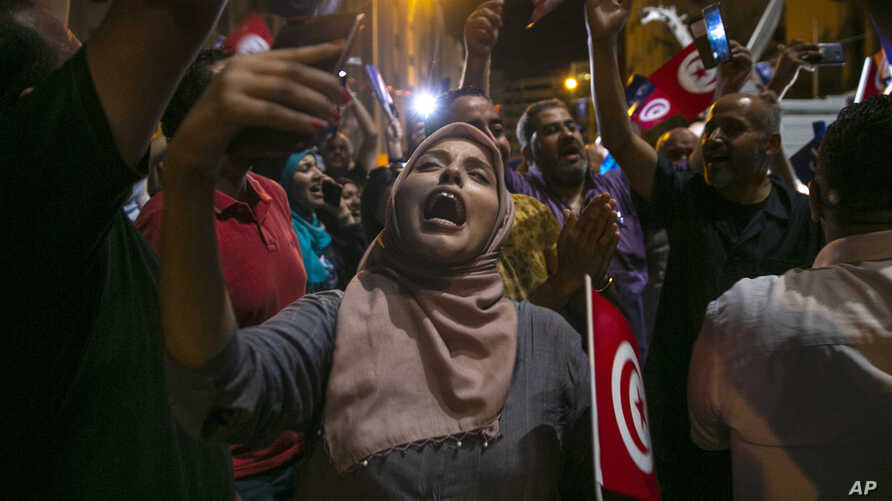 Supporters of the Islamist party Ennahda react as they follow exit polls in Tunis, Tunisia, Oct. 6, 2019.