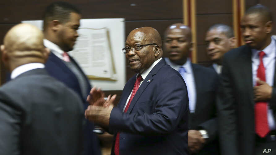 Former South African President Jacob Zuma, center, is seen in the High Court in Pietermaritzburg, South Africa, Oct. 11, 2019.