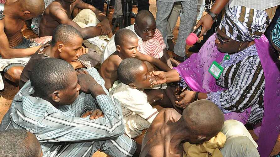 Dr. Hadiza Sabuwa Balarabe, acting governor of Kaduna state, inspects people rescued from a purported correctional facility in Zaria, at the Kaduna state headquarters of the Nigeria Security and Civil Defense Corps. (Kaduna state government photo)