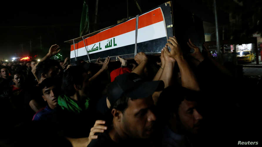 Men carry the coffin of a demonstrator who was killed during anti-government protests, in Baghdad, Iraq, Oct. 4, 2019.