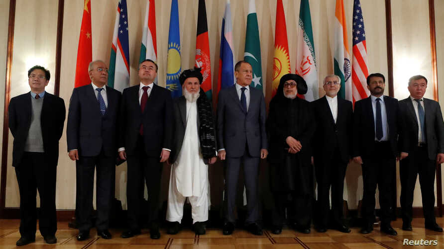 FILE - Russian Foreign Minister Sergey Lavrov (C) poses for a photo with members of delegations during multilateral peace talks on Afghanistan in Moscow, Russia, Nov. 9, 2018.