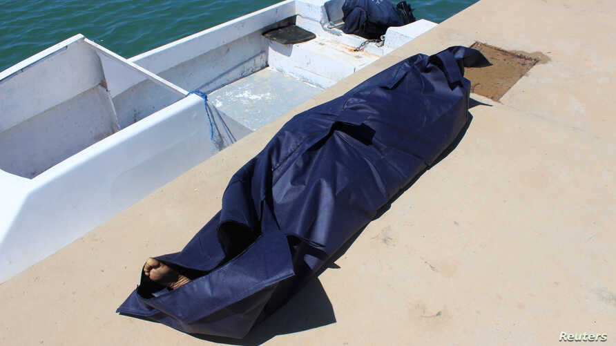 FILE - A bag containing the body of a migrant who died in an unsuccessful crossing of the Mediterranean Sea is seen in the twon of Qarabulli, east of the capital Tripoli, Libya, June 2, 2019.
