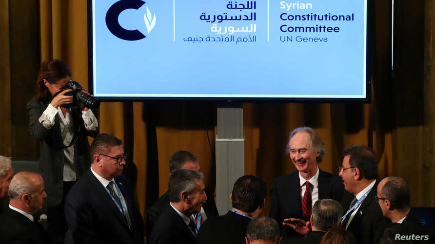 U.N. Special Envoy for Syria Geir Pedersen talks with members of Syrian delegations after the first meeting of the new Syrian Constitutional Committee at the United Nations in Geneva, Switzerland, Oct. 30, 2019.