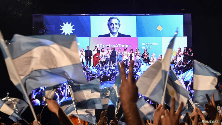 Supporters of Alberto Fernandez and his running mate and former President Cristina Fernandez de Kirchner, celebrate after Alberto Fernandez wins the general election, in Buenos Aires, Argentina, Oct. 27, 2019.