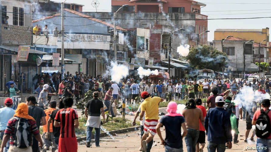 Demonstrators are seen during clashes in Santa Cruz, Bolivia, Oct. 23, 2019.
