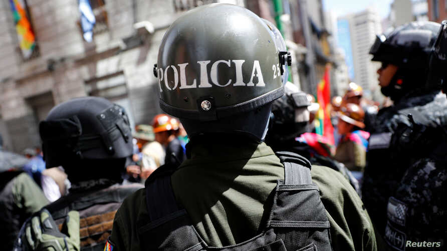 Security forces stand guard in front of the Presidential Palace during a protest in La Paz, Bolivia, Oct. 29, 2019.