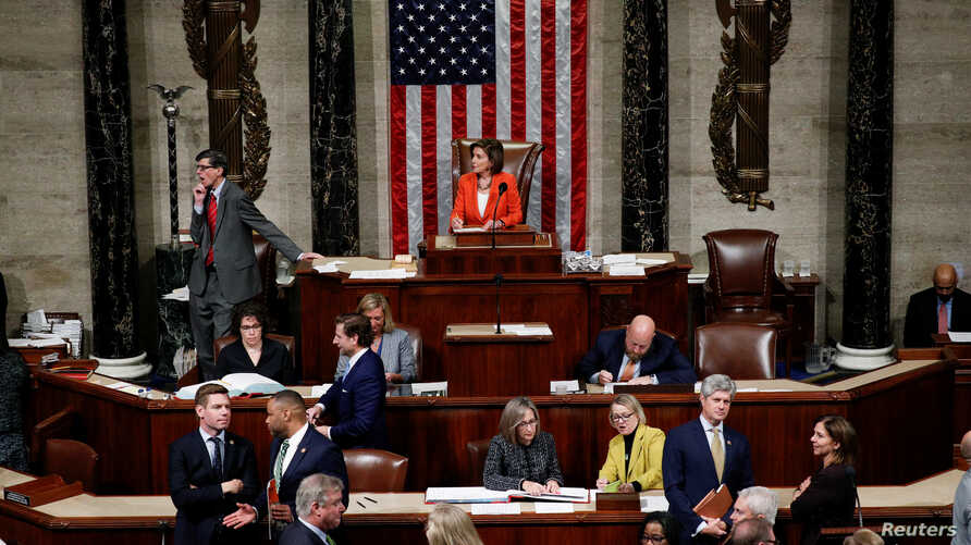 Speaker of the House Nancy Pelosi presides over the U.S. House of Representatives vote on a resolution that sets up the next steps in the impeachment inquiry of U.S. President Donald Trump on Capitol Hill in Washington, D.C.
