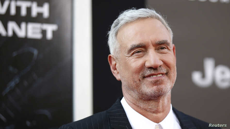 """FILE - Director Roland Emmerich arrives at the premiere of his film """"Independence Day: Resurgence"""" in Hollywood, California, June 20, 2016."""