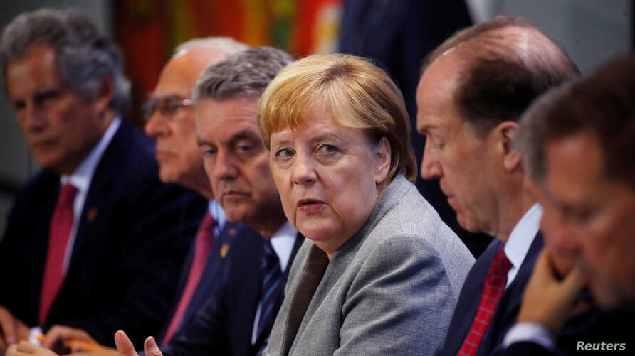 German Chancellor Angela Merkel attends a news conference after meeting with chairmen of international economic and financial organizations at the Chancellery in Berlin, Germany, Oct. 1, 2019.