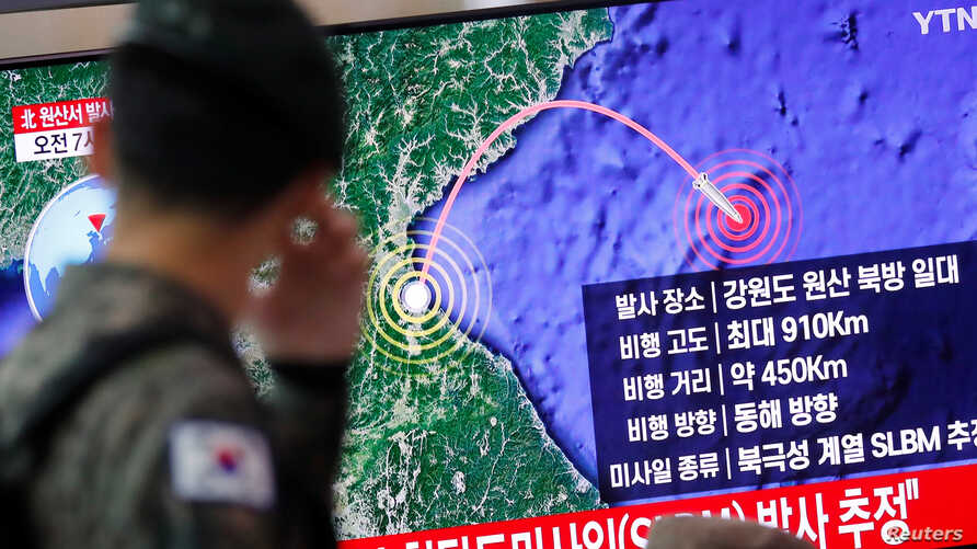 A South Korean soldier walks past a TV broadcasting a news report on North Korea firing a missile that is believed to be launched from a submarine, in Seoul, South Korea, Oct. 2, 2019.