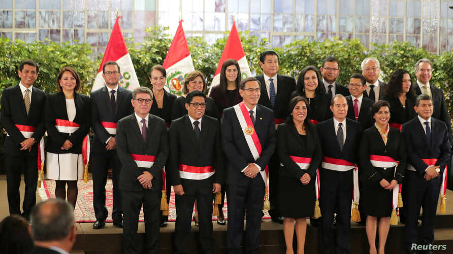 Peru's President Martin Vizcarra and newly appointed ministers pose for a picture during their swearing-in ceremony at the government palace in Lima, Peru, Oct. 3, 2019.
