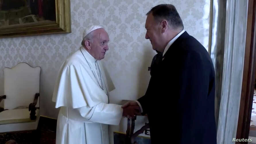 U.S. Secretary of State Mike Pompeo shakes hands with Pope Francis on the sidelines of a symposium at the Vatican, October 3, 2019 in this still image taken from a video.
