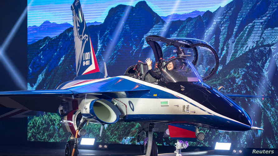 "Taiwan's President Tsai Ing-wen attends an unveiling ceremony for a prototype of advanced jet trainer ""Brave Eagle"" in Taichung, Sept. 24, 2019. (Military News Agency/Handout)"