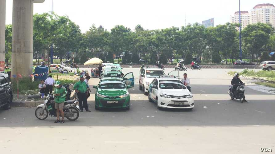 Grab competes with traditional taxis in Vietnam.