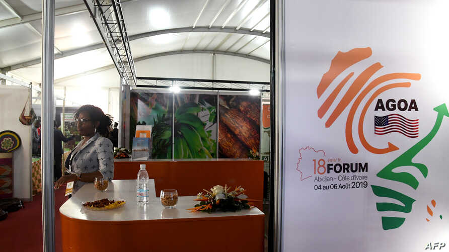 A woman looks on behind a stand during the 18th African Growth and Opportunity Act (AGOA) forum, an exhibition of eligible…