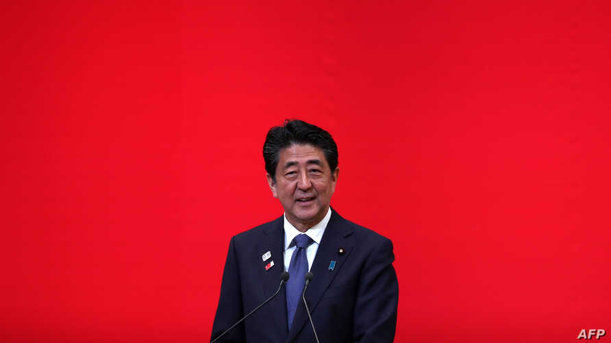 (FILES) In this file photo taken on July 24, 2019 Japan's Prime Minister Shinzo Abe delivers a speech during a ceremony marking…
