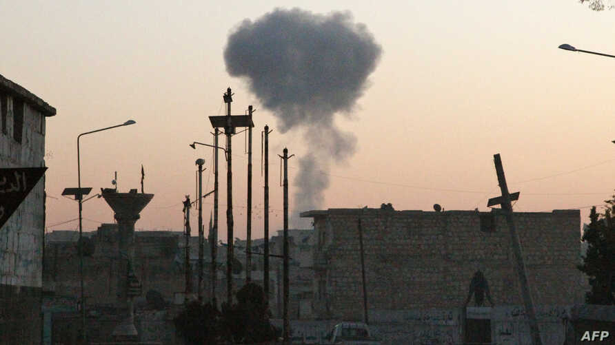 EDITORS NOTE: Graphic content / Smoke rises following a reported Russian airstrike on the town of Maaret al-Numan in Syria's…