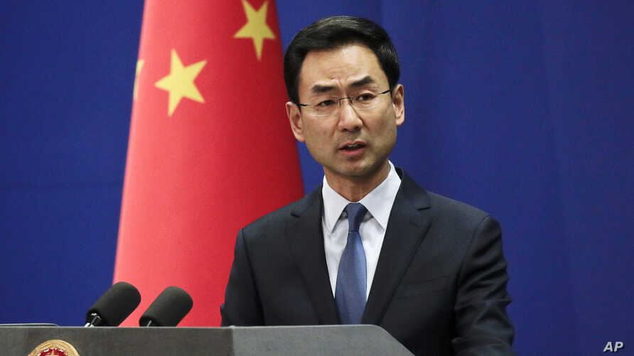 FILE - In this file photo dated Tuesday, Jan. 29, 2019, Chinese Foreign Ministry spokesman Geng Shuang speaks during a daily…