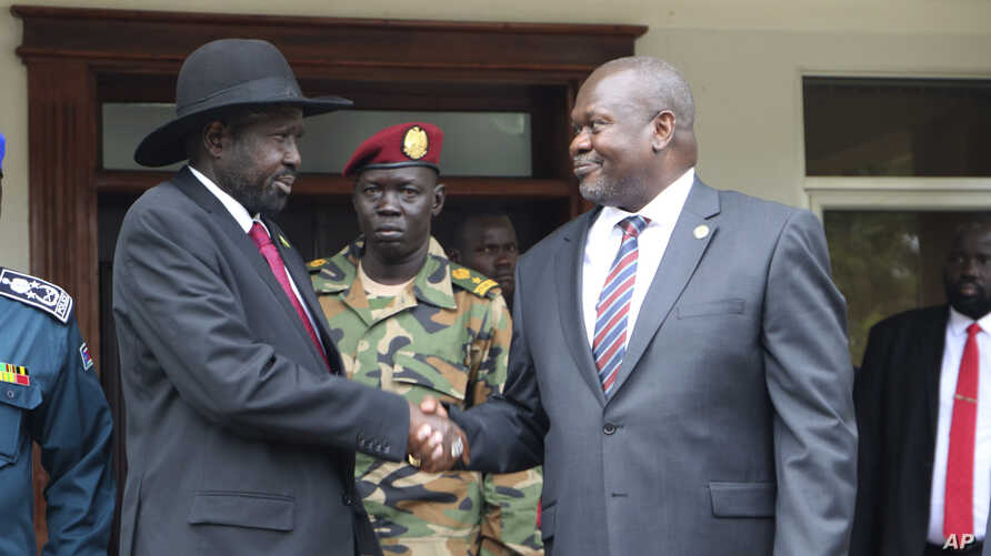 South Sudan's President Salva Kiir left, and opposition leader Riek Machar, right, shake hands after meetings on Oct. 20.