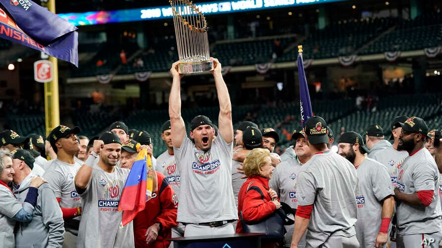Washington Nationals first baseman Ryan Zimmerman celebrates with the trophy after Game 7 of the baseball World Series against the Houston Astros,  Oct. 30, 2019, in Houston. The Nationals won 6-2 to win the series.