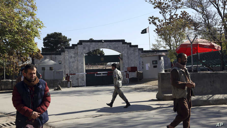 Security walks in front of the Pakistan Embassy in Kabul, Afghanistan, Monday, Nov. 4, 2019. The embassy issued a statement…