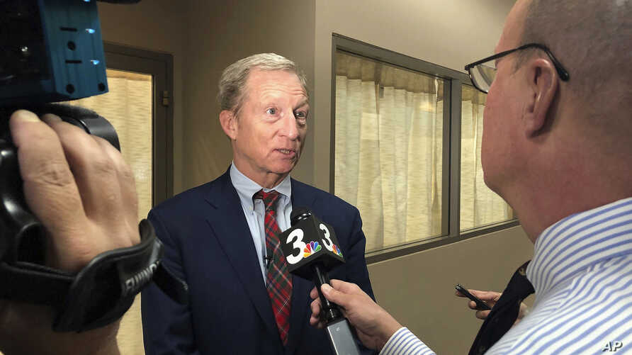 Democratic presidential candidate Tom Steyer speaks to reporters before hosting a town hall in Henderson, Nev.