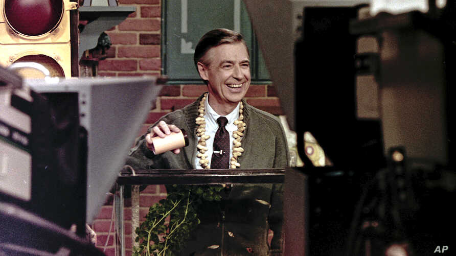 This June 28, 1989 file photo shows Fred Rogers taping a segment of his television program Mister Rogers' Neighborhood in Pittsburgh.