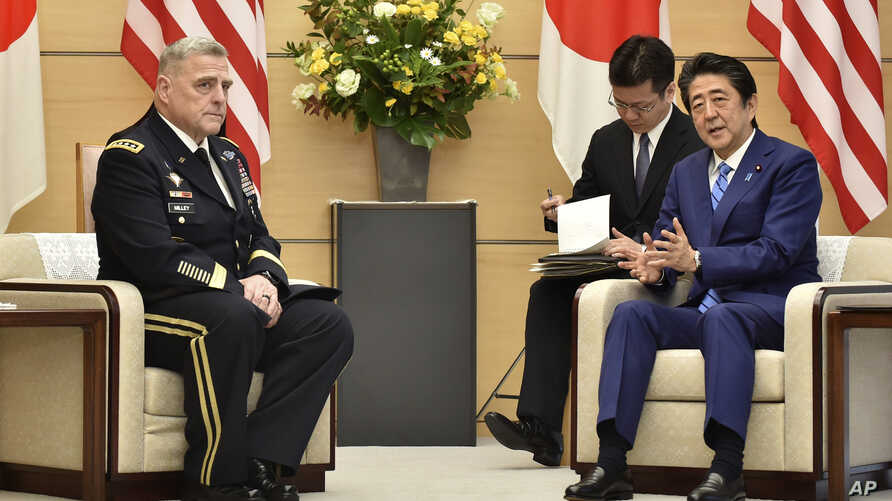 Japan's Prime Minister Shinzo Abe, right, meets with U.S. Chairman of the Joint Chiefs of Staff Gen. Mark Milley, left, at the Abe's office in Tokyo, Nov. 12, 2019.