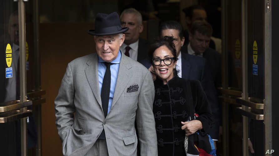Roger Stone with his wife Nydia Stone, right, leave federal court Washington, Tuesday, Nov. 12, 2019. Stone, a longtime…