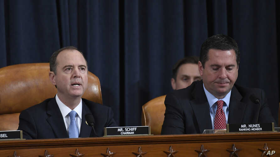 House Intelligence Committee Chairman Adam Schiff of Calif., left, speaks as Rep. Devin Nunes, R-Calif., listens.