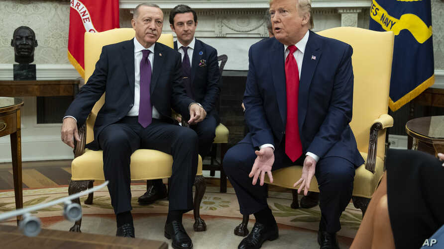 President Donald Trump meets with Turkish President Recep Tayyip Erdogan in the Oval Office of the White House, Wednesday, Nov…
