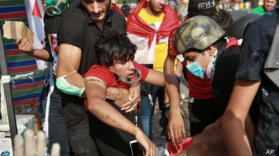 An injured protester is rushed to a hospital during clashes between Iraqi security forces and demonstrators, in Baghdad, Iraq, Nov. 14, 2019.