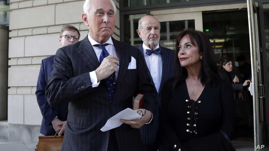 Roger Stone, left, with his wife Nydia Stone, leaves federal court in Washington, Friday, Nov. 15, 2019.